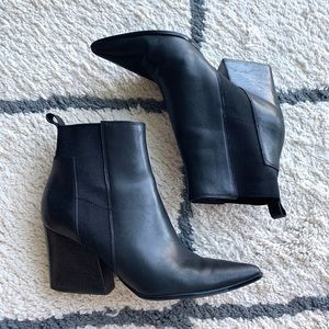 Black pointy toe leather boots